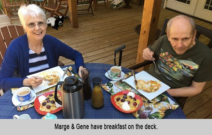 Marge and Gene have breakfast on the deck.